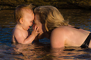 Mother and baby girl playing in a tidepool ****Model Release available