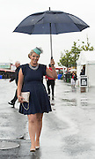 01/08/2014 Laura Mooney from Kilkenny at a very wet Galway race track in Ballybrit for the Friday evening of the Galway races  .Photo:Andrew Downes