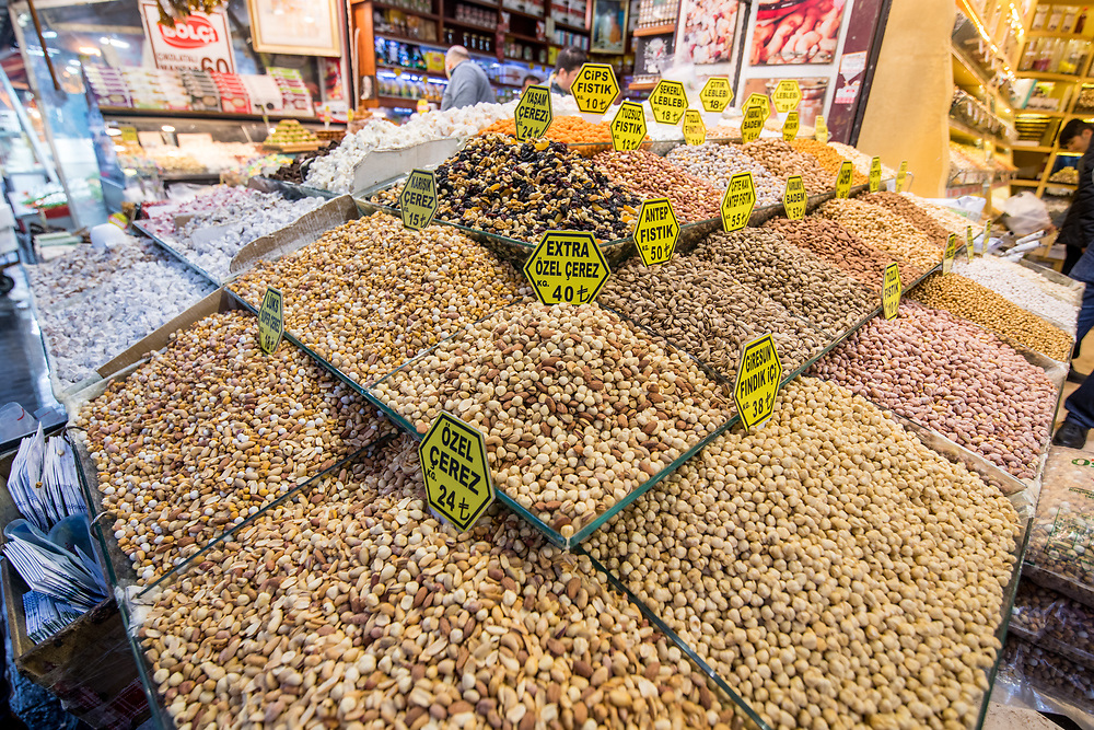 Corner of a market stall is overflowing with a variety of nuts on display for sale at Istanbul Spice bazaar in Turkey
