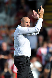 Charlton Athletic Manager, Bob Peeters applauds his team's supporters after the match - Photo mandatory by-line: Patrick Khachfe/JMP - Mobile: 07966 386802 09/08/2014 - SPORT - FOOTBALL - Brentford - Griffin Park - Brentford v Charlton Athletic - Sky Bet Championship - First game of the season