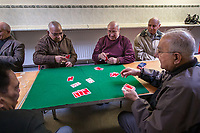Leicester, United Kingdom: Men play cards at a luncheon club for the elderly, most of whom are from North India and East Africa, which meets weekly at a Hindu temple.