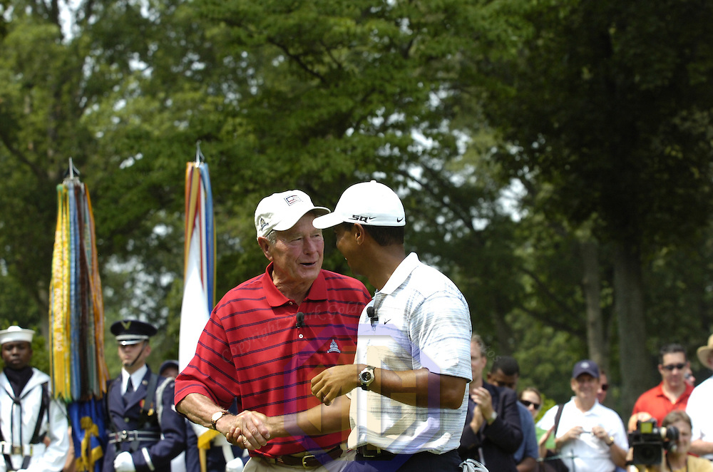 04 July 2007:  Former President George H. W. Bush (L) is congratulated by Tiger Woods (R) after teeing off to start the inaugural AT&T National PGA event at Congressional Country Club in Bethesda, Md. The proceeds of the golf tournament will benefit the Tiger Woods Foundation and local Washington, DC, based charities.   ****For Editorial Use Only