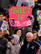 A Kansas City Royals fan holds a sign at the end of a baseball game against the Chicago White Sox after Royals' won their 16th game of the season at Kauffman Stadium in Kansas City, Mo., Saturday, May 4, 2013. The Royals shutout the White sox, 2-0. (AP Photo/Colin E. Braley).