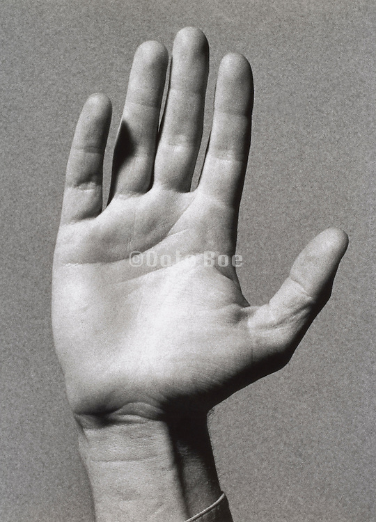 A man's hand with the palm out