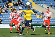Oxford forward Jordan Bowery and Stevenage defender Dean Wells battle for the ball during the Sky Bet League 2 match between Oxford United and Stevenage at the Kassam Stadium, Oxford, England on 25 March 2016. Photo by Alan Franklin.