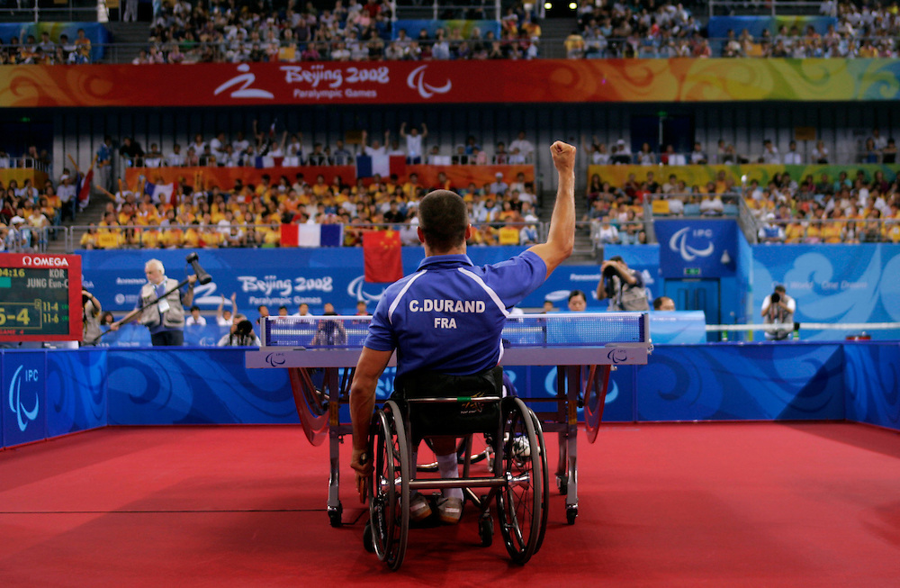 France's Christophe Durand celebrates a point scored against Korea's Jung Eun-Chang during the gold medal Singles sitting Class 4-5 Table Tennis match  at the Paralympic Games in Beijing , China, Thursday, Sept.11, 2008. Durand won the Gold medal.