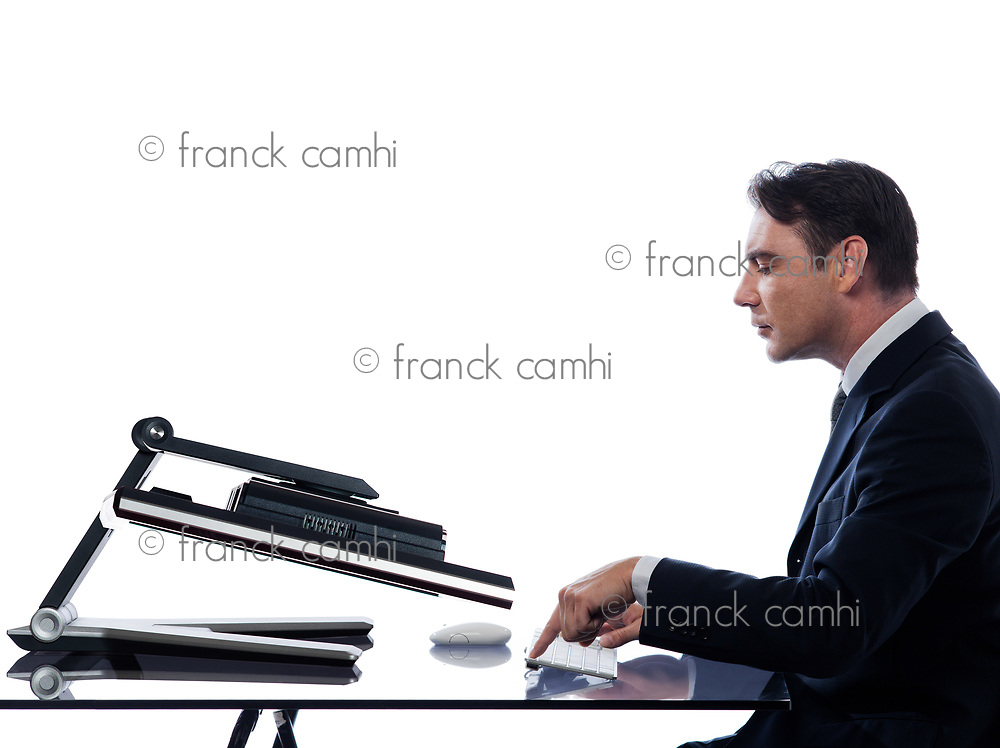 relationship between a caucasian man and a computer display monitor on isolated white background expressing breakdown concept