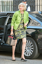 © Licensed to London News Pictures. 08/07/2014. Westminster, UK Theresa May, Home Secretary,  arriving on Downing Street today 8th July 2014 for the weekly cabinet meeting. Photo credit : Stephen Simpson/LNP