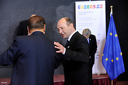Traian Basescu, Romania's president, right, speaks with Silvio Berlusconi, Italy's prime minister, during the European Union summit at EU headquarters in Brussels, Belgium, on Sunday, March. 1, 2009. .(Photo © Jock Fistick)