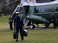The military aide walks to Marine One with &quot;the football&quot; for President Donald Trump on January 25, 2017.<br /> Photo by Dennis Brack