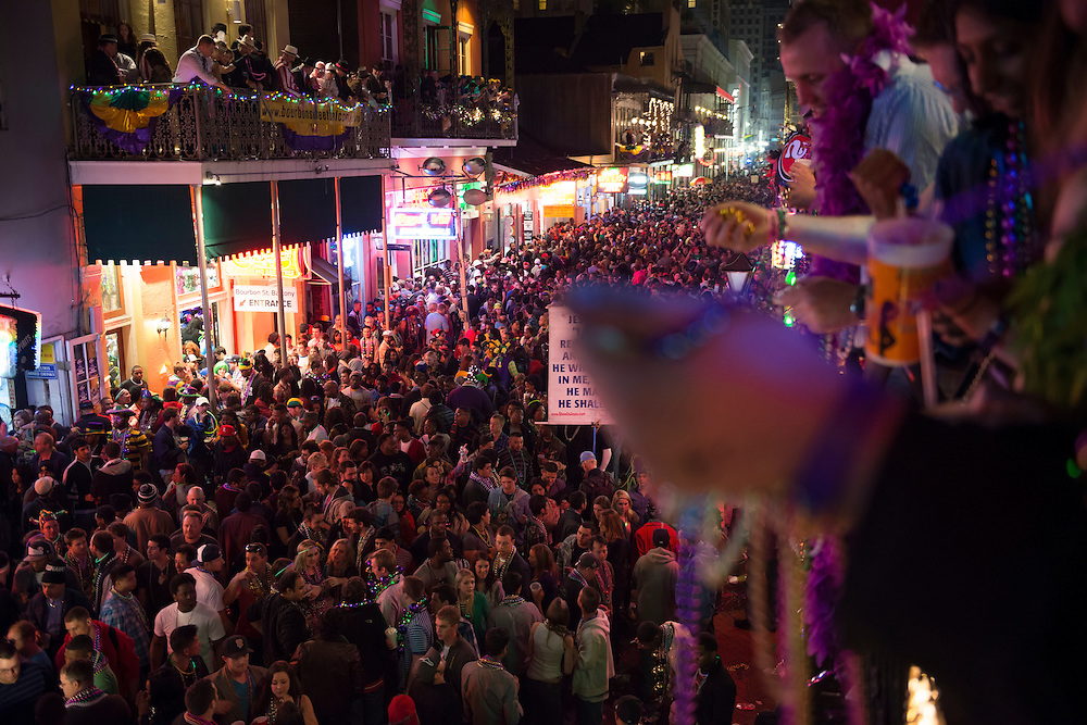 People crowd the balconies and Bourbon Street in the French Quarter during Mardi Gras 2013.