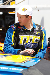 STOCKTON, CA - MAY 03:  Giles Thornton driver of the #12 TTC Racing/Montana Raceway Park Toyota exits his car during practice for the NASCAR K&N Pro Series West Stockton 150 at the Stockton 99 Speedway on May 3, 2014 in Stockton, California. (Photo by Jason O. Watson/Getty Images for NASCAR) *** Local Caption *** Giles Thornton