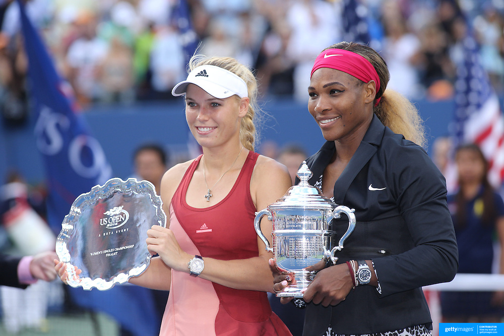 Serena Williams, USA, and Caroline Wozniacki, (left), Denmark, at the trophy presentation after the  Women's Singles Final during the US Open Tennis Tournament, Flushing, New York, USA. 7th September 2014. Photo Tim Clayton