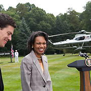 US Secretary of State Condoleezza Rice and British Foreign Secretary David Milleband look on as President Bush and Prime Minister of Britain Gordon Brown hold a joint press availability at Camp David Monday, July 30, 2007...Photo by Khue Bui..