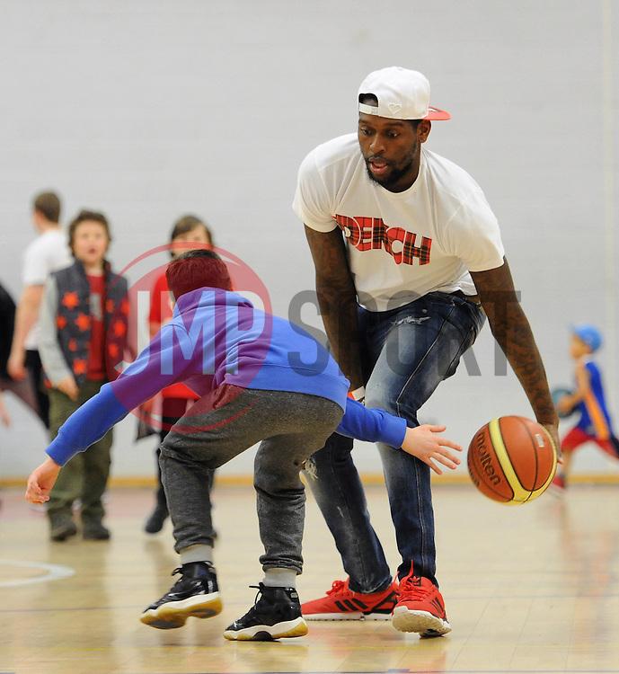 Jay Emmanuel-Thomas plays basketball with a fan - Photo mandatory by-line: Dougie Allward/JMP - Mobile: 07966 386802 - 27/02/2015 - SPORT - basketball - Bristol - SGS Wise Campus - Bristol Flyers v Leeds Force - British Basketball League