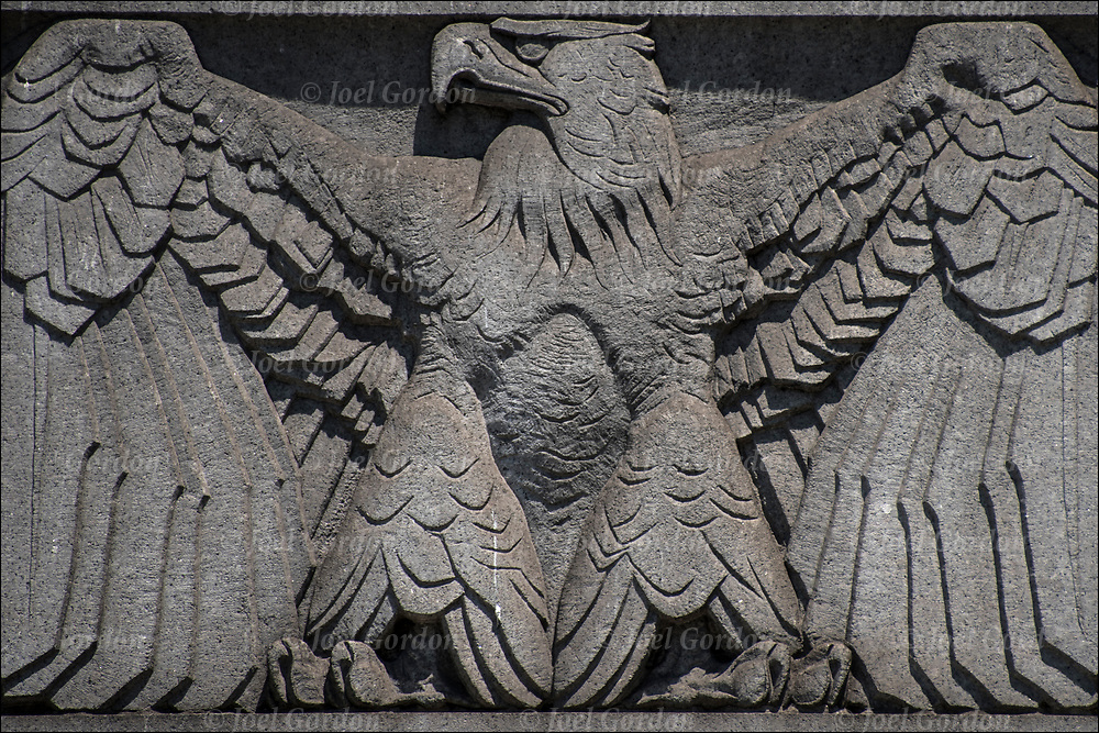 Looking up at carved American Eagle, on office building in lower Manhattan.<br /> <br /> The eagle is the  symbol of and for the  United States. It also represents patriotism.