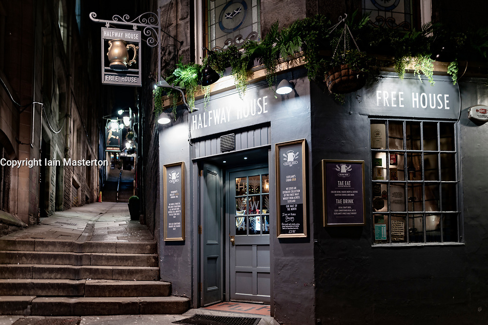 Night view of Halfway House pub in Fleshmarket Close in Edinburgh Old Town, Scotland, UK