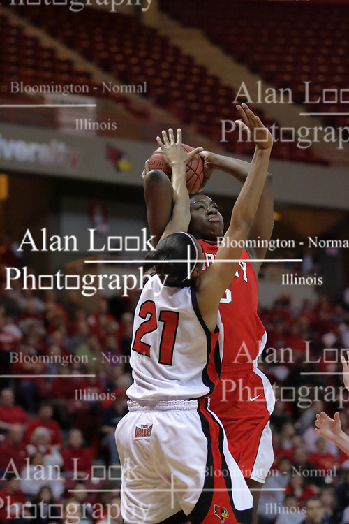 26 February 2009: Kenyatta Shelton gets in the face and body of a shooting Sonya Harris.  The Braves of Bradley  and the Illinois State Redbirds battled it out on Doug Collins Court inside Redbird Arena on the campus of Illinois State University, Normal Il.