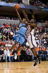 North Carolina guard Quentin Thomas (11) is fouled by Virginia guard/forward Mamadi Diane (24).  The Virginia Cavaliers men's basketball team faced the #3 ranked North Carolina Tar Heels  at the John Paul Jones Arena in Charlottesville, VA on February 12, 2008.