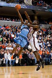 North Carolina guard Quentin Thomas (11) is fouled by Virginia guard/forward Mamadi Diane (24).  The Virginia Cavaliers men's basketball team faced the #3 ranked North Carolina Tar Heels  at the John Paul Jones Arena in Charlottesville, VA on February 12, 2008.