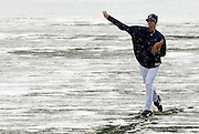 Indina's pitcher Tom Mastny warms up before Friday's home opener against the Seatle Mariners. The game was eventualy snowed out in the fifth inning. (Chronicle photo/Jason Miller)