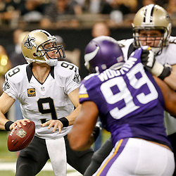 Sep 21, 2014; New Orleans, LA, USA; New Orleans Saints quarterback Drew Brees (9) passes against the Minnesota Vikings during the second quarter of a game at Mercedes-Benz Superdome. Mandatory Credit: Derick E. Hingle-USA TODAY Sports