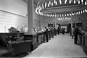 31/07/1962<br /> 07/31/1962<br /> 31 July 1962<br /> Interior of Ulster Bank, College Green, Dublin. Lady at enquiries desk is Miss M. McNally. Note aerial photograph of city centre in background. Photos, Photo, Snap, Streets, Street,