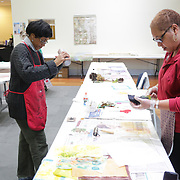 "Instructor September Krueger, left, mixes paint while Althea Johnson paints a quilt square during ""Create Your Own Quilt Squares"" Sunday November 23, 2014 at the Cameron Art Museum in Wilmington, N.C. (Jason A. Frizzelle)"