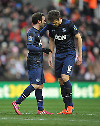 Manchester United's Juan Mata talks with Manchester United's Michael Carrick  - Photo mandatory by-line: Alex James/JMP - Tel: Mobile: 07966 386802 01/02/2014 - SPORT - FOOTBALL - Britannia Stadium - Stoke-On-Trent - Stoke v Manchester United - Barclays Premier League