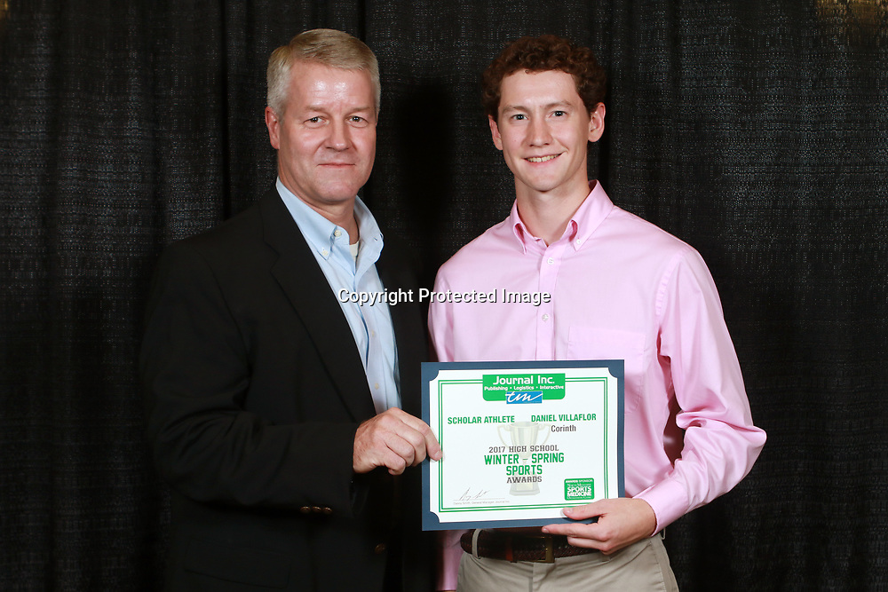 Daniel Villaflor of Corinth High School, here with Journal Inc. CEO Clay Foster, was named one of the Scholar Athlete of the Year.