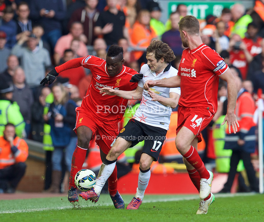LIVERPOOL, ENGLAND - Sunday, March 22, 2015: Liverpool's Mario Balotelli in action against Manchester United's Daley Blind during the Premier League match at Anfield. (Pic by David Rawcliffe/Propaganda)