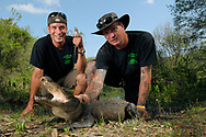 BUSHNELL-APRIL 23: Robbie, right, and Stephen Keszey, of the Discovery Channel television show Swamp Brothers, hold alligators on April 23, 2011 in Bushnell, Florida.  (Photo by Phelan M. Ebenhack/Getty Images for Discovery Communications LLC)