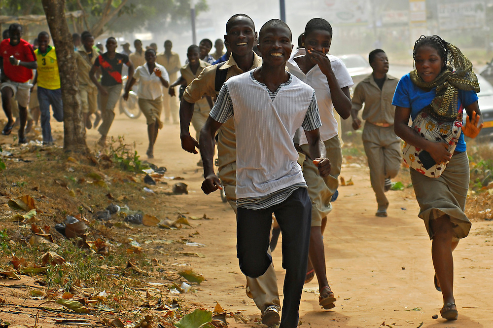 11-12-14  --  LOMÉ, TOGO  --  Students protest at the Technical School (Lycee Thechnique) in Adidogome, a suburb of Lomé, on December 14. Police fired tear gas and flash-bangs into crowds of high-school aged students; they are upset that government-paid teachers, who have not been paid, are on strike. Photo by Daniel Hayduk