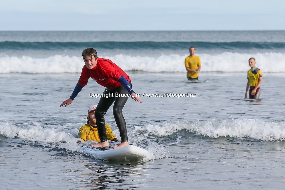 Flight Centre Halberg Disability Sport Foundation Raglan Surf Day on Sunday 20 March 2016.<br /> <br /> Copyright Photo: Bruce Lim / www.photosport.nz