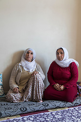 Liwaza Zamba, 57 (left) and daughter Zaide Gul, 37, (right) photographed in Diyarbakir, Turkey on March 23, 2017. Both lost homes in the Hasirli neighborhood in Sur. Liwaza Zamba moved to Sur in 1993 after the military destroyed her home in a nearby village.
