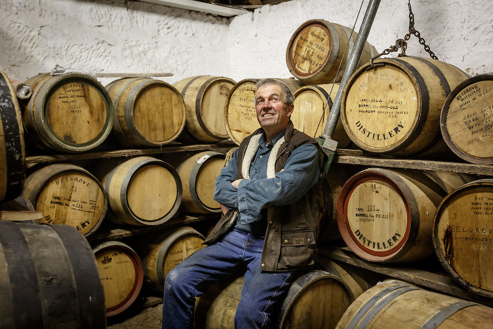 Distillery owner Peter Bignell sits inside the bond store at Belgrove Distillery in Kempton, Tasmania, August 25, 2015. The entire distillery is a former stable sub-divided into four sections: still, mashing, tasting room, and bond store. Gary He/DRAMBOX MEDIA LIBRARY
