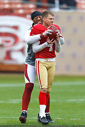 Nov 20, 2011; San Francisco, CA, USA; Arizona Cardinals wide receiver Larry Fitzgerald (back) jokes with San Francisco 49ers punter Andy Lee (4) before the game at Candlestick Park. San Francisco defeated Arizona 23-7. Mandatory Credit: Jason O. Watson-US PRESSWIRE