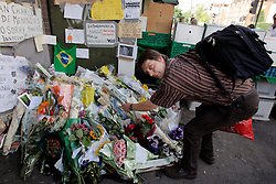 UK ENGLAND LONDON 28JUL05 - BILD-reporter Peter Moufarrege lays down flowers at Stockwell station for Jean Charles De-Menenzies, a 28-year old Brazilian electrician who was shot dead in error by plain-clothes policemen although he was not connected to the recent terrorist attacks...jre/Photo by Jiri Rezac ..© Jiri Rezac 2005..Contact: +44 (0) 7050 110 417.Mobile:  +44 (0) 7801 337 683.Office:  +44 (0) 20 8968 9635..Email:   jiri@jirirezac.com.Web:    www.jirirezac.com..© All images Jiri Rezac 2005 - All rights reserved.
