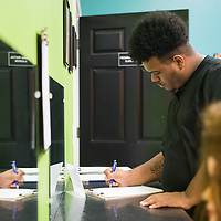 Kristofer Jenkins signs out of his freshman level cosmetology class, where the students reviewed the anatomy and physiology of the skin layers at the Tupelo Academy of Cosmetology. Freshman must complete 240 clock hours before moving to the junior level in the program.
