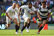 'Twickenham - Sunday 30 May, 2010: Steffon Armitage of England runs with the ball as Mike Tindall (L) urges him on during the match between England and the Barbarians at Twickenham. (Pic by Andrew Tobin/Focus Images)