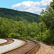 """""""Rhythm of the Rails""""<br /> <br /> A beautiful curving set of double railroad tracks in Ohiopyle PA.<br /> <br /> Laurel Highlands Area of Pennsylvania by Rachel Cohen"""
