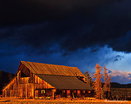 Dramatic stormy light highlights an old barn near Whitefish Montana