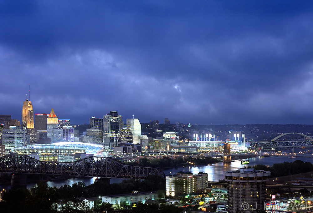 Twilight photograph of the Cincinnati skyline with both the Great American Ball Park and Paul Brown Stadium lit up