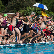 Brockwell Lido during their 80th birthday celebration day, including races and various generations jumping into the pool.