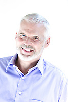 caucasian senior man portrait toothy smile isolated studio on white background