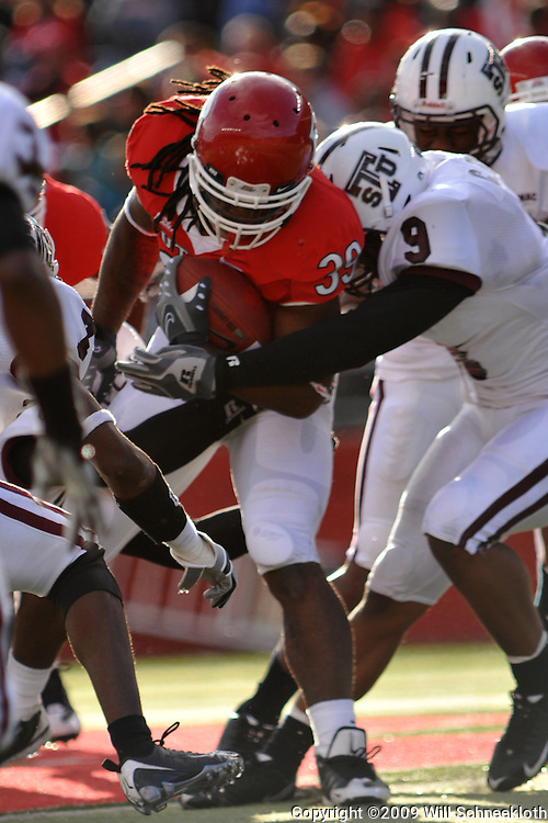 Oct 10, 2009; Piscataway, NJ, USA; Texas Southern defensive back Curtis Thomas (9) wraps up Rutgers running back Jourdan Brooks (39) during first half NCAA college football action between Rutgers and Texas Southern at Rutgers Stadium.