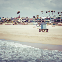 Seal Beach California coastline retro summer photo with the Pacific Ocean, lifeguard tower, and oceanfront homes. Seal Beach is in Orange County Southern California in the United States of America.