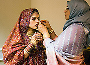 Families of Abraham Documentary Project, Muslim bride dressing for her wedding in Charlotte, NC.