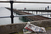 A crumpled newspaper on Southend Pier, the world's longest at a mile and a quarter, at Southend-on-Sea, Essex.