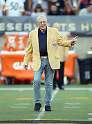 Former Green Bay Packers general manager Ron Wolf waves as he is introduced as a newly enshrined member of the NFL Pro Football Hall of Fame before the Pittsburgh Steelers 2015 NFL Pro Football Hall of Fame preseason football game against the Minnesota Vikings on Sunday, Aug. 9, 2015 in Canton, Ohio. The Vikings won the game 14-3. (©Paul Anthony Spinelli)